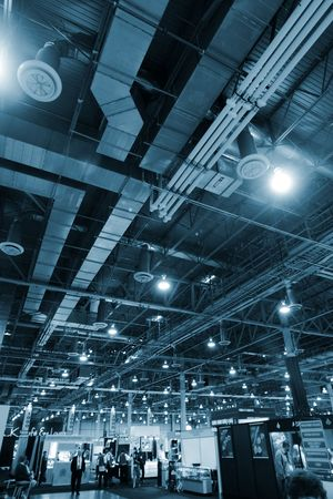 Huge industrial space hosting a trade show. Stock Photo - 2483690