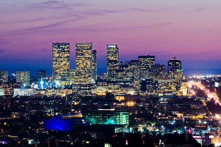 Los Angeles skyline at dusk. View of Century City and Pacific Ocean.