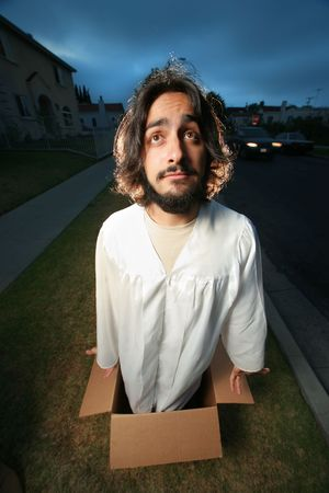 Funny man looking like Jesus coming out of the box. Wide angle. photo