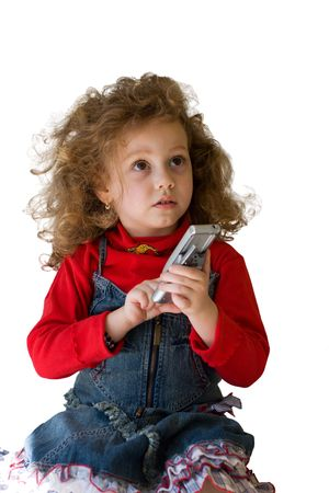 Little girl using mobile phone photo