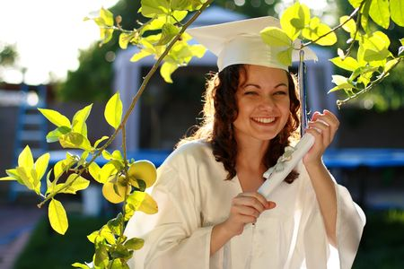 Young graduate woman happy with diploma photo