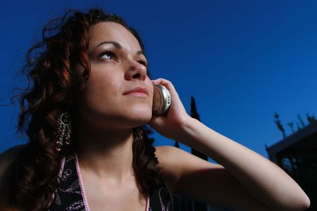 Young woman calling on a cell phone at night Stock Photo - 2483248