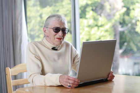 shallow dof: Elderly lady with laptop. Shallow DOF.