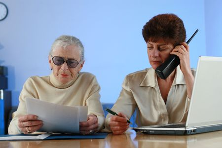 social worker: Social worker helping senior woman. Stock Photo