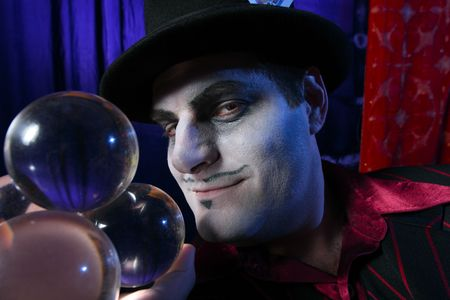 Magician with crystal balls photo