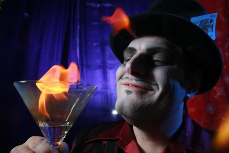Magician with flaming martini glass.