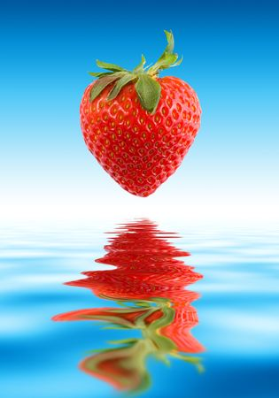 Beautiful Strawberry Over Water. Stock Photo