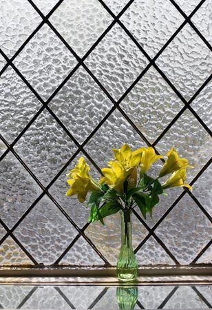 rhomb: Yellow flowers bouquet at vitrage window Stock Photo