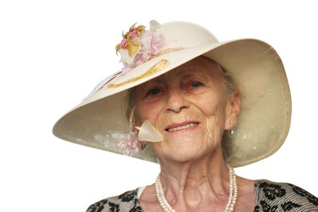 Portrait of a senior woman in retro hat, isolated on white. photo