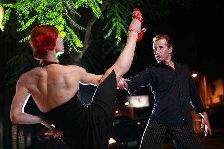 latin dance: Couple dancing hot latin dance on a street at night