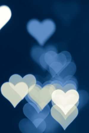 Blurred valentine background with heart-shaped highlights. photo