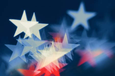 Blurred holiday background with star-shaped highlights. photo