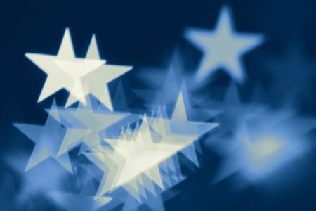 highlights: Blurred holiday background with star-shaped highlights.