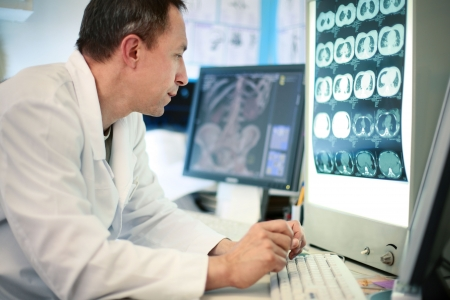 diagnostics: Doctor looking at ct scan Stock Photo