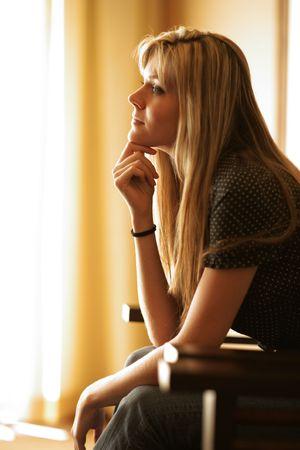 dark side: Beautiful young woman thinking