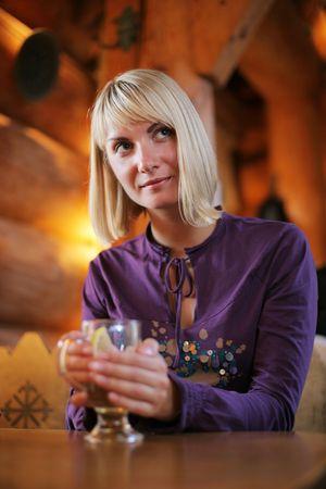 Beautiful young woman enjoying a drink. Shallow DOF. photo