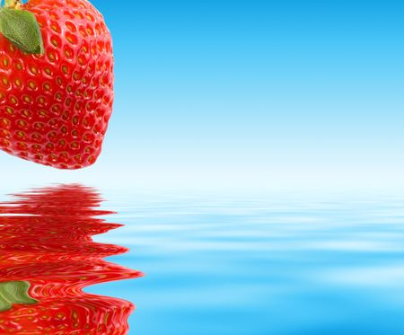Red strawberry over blue water. Macro, close-up.