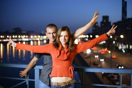 Loving young couple in night city