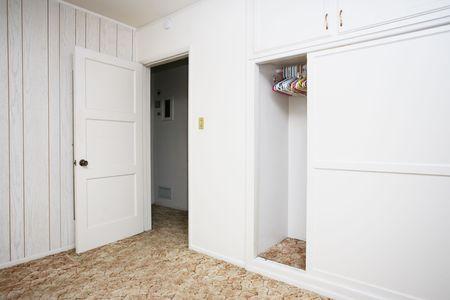 apt: Empty room with white walls and wardrobe closet