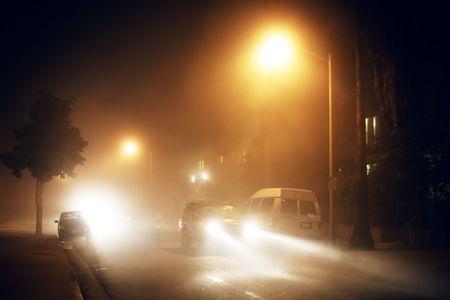 Foggy street at night photo