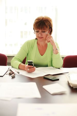 Business woman reading text message on mobile phone Stock Photo - 2642800