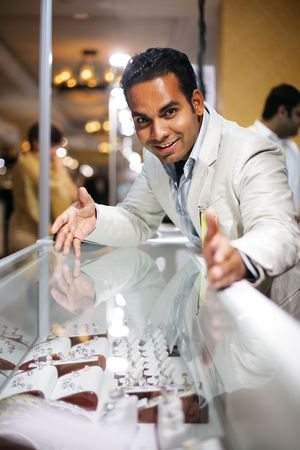 jewelry store: Businessman selling diamond jewellry