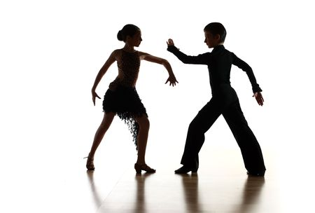 Young dancers in latin dance pose