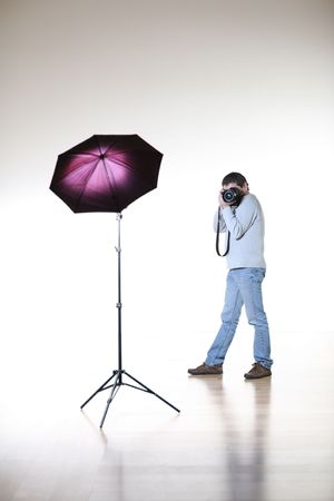 Photographer shooting in studio photo