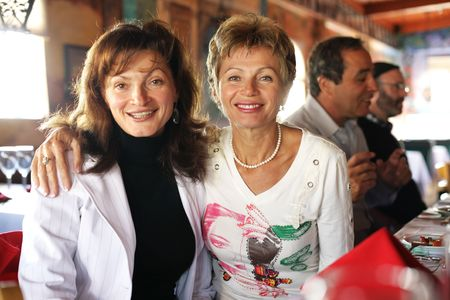 Two happy mature sisters at  reunion. Shallow DOF.