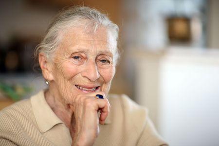 old photo: Happy senior woman portrait, close-up, shallow DOF. Stock Photo