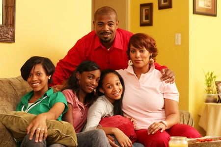 black youth: Happy family of five together at home