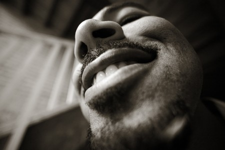 teeths: Fun wide angle portrait of a man. High grain effect. Stock Photo