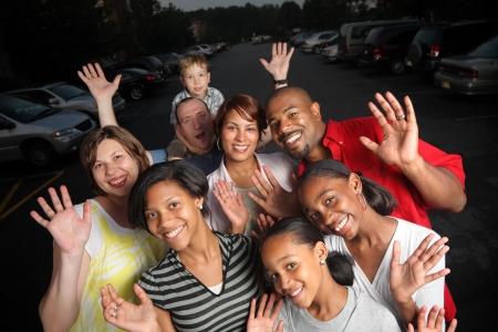 cultural diversity: Feliz grupo de amigos al aire libre junto al crep�sculo Foto de archivo