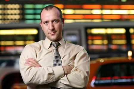 stockbroker: Businessman over stock exchange background
