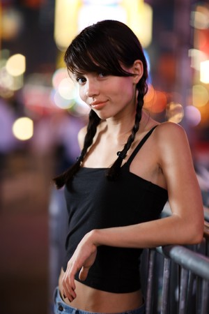 Beautiful girl posing in New York City. Shallow DOF. photo