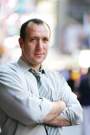 stockbroker: Confident mature businessman in a city