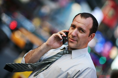 Businessman talking on cellular phone in New York city photo