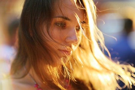 blown: Portrait of a beautiful young woman at sunset. Close-up, shallow DOF.