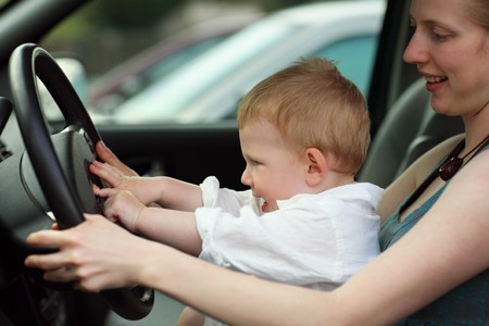 Little boy at drivers seat together with mother. Shallow DOF. photo