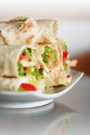 wrap: Plate of freshly made wraps. Shallow DOF. Stock Photo
