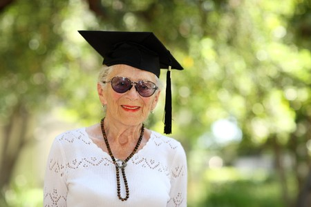 Happy senior woman in graduate cap Stock Photo - 4214695