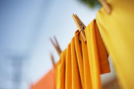 laundry: Colorful clothes drying on clothesline. Shallow DOF.