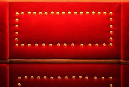 rivets: Red velvet with golden rivets retro background