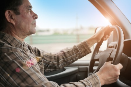 Man driving van or SUV. photo