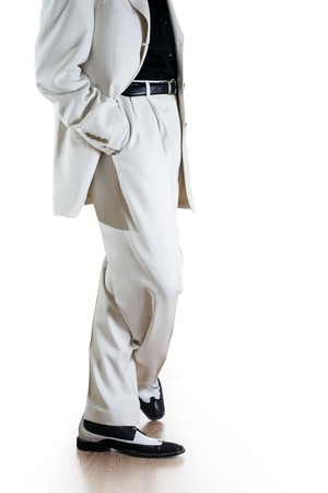 hands in pockets: Man in white suit isolated on white