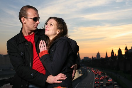 Young couple in Moscow city at sunset photo