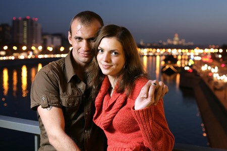 Young couple in night city photo