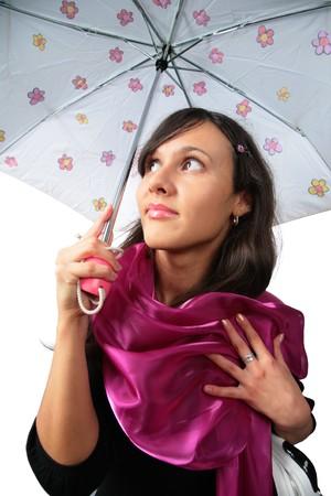 Beautiful brunette girl under umbrella photo