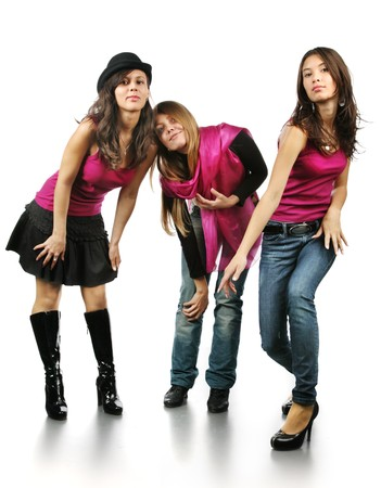 russian hat: Three beautiful young women in studio over white background Stock Photo
