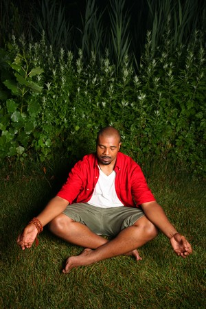 African American man practicing yoga outdoors photo